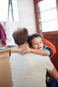 Father and son hug goodbye before school — Stock Photo