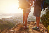 Hikers legs standing on hiking path — Stock Photo
