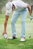 Golf man putting on green for birdie — Stock Photo