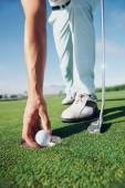 Golf man putting on green — Stock Photo