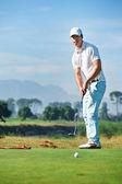 Golf man putting on green — Stock Photo