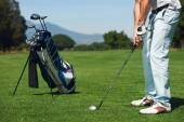 Golfer man hitting golf ball — Stock Photo