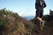 Running man on mountain trail — Stock Photo