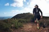Trail running man on mountain — Stock Photo
