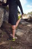 Trail runner stretching before running — Stock Photo