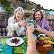 Friends toasting to celebration with drinks — Stock Photo #74980293
