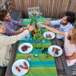 Friends toasting to celebration with drinks — Stock Photo #74980297