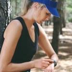 Woman checking on gps sports watch — Stock Photo #74982409
