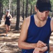 Couple check time on gps watch — Stock Photo #74982447