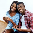 African couple looking on tablet — Stock Photo #74985109