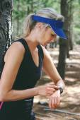 Woman checking on gps sports watch — Stock Photo