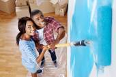 Black couple painting wall — Stock Photo