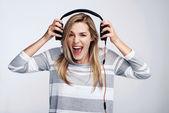 Girl listening to music on headphones — Stock Photo