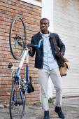 African man with bicycle walking — Stock Photo