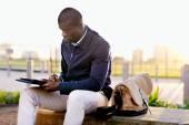 Black businessman using tablet — Stock Photo