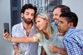 Friends taking selflie at garden party — Stock Photo