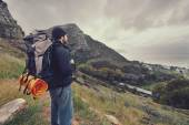 Man hiking wilderness mountain with backpack — Stock Photo