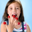 Young child eating raspberries — Stock Photo #80871826