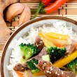 Bowl of beef rice on a bamboo mat — Stock Photo #80882242