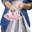 Woman holding shopping bags and Euro — Stock Photo #51955289