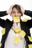 Businesswoman with paper notes — Stock Photo