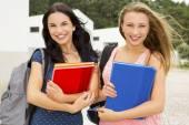 Two beautiful teenage students — Stock Photo
