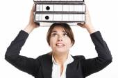 Business woman carying folders — Stockfoto