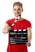 Holding a clapboard — Stock Photo