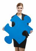 Businesswoman with a puzzle piece — Stock Photo