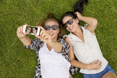 Best friends taking selfies — Stok fotoğraf