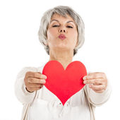 Holding a heart in her hands — Stock Photo