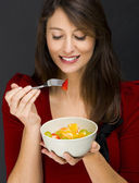 Woman eating a fruit salad — Stock Photo