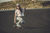 Skater girl making dowhill — Stock Photo