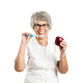 Woman with  tooth-brush and apple — Stock Photo