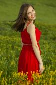 Beautiful woman in a red dress — Stock Photo