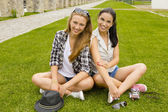 Best Friends sitting on the grass — Stock Photo