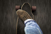 Man feet riding a skateboard — Стоковое фото