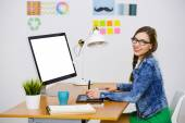 Businesswoman in a creative office — Stock Photo