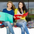 Teenage students studying together in the school — Stock Photo #79367886