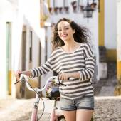 Happy girl riding a bicycle — Stock Photo