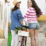 Female tourists walking together — Stock Photo #82908138