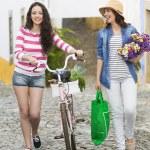 Female tourists walking together — Stock Photo #82908142