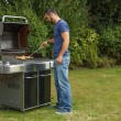 Man at a barbecue grill — Stock Photo #51925139