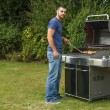 Man cooking meat — Stock Photo #51925157