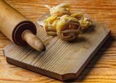 Rolling pin with pasta — Stock Photo
