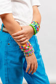 Boy wearing bracelets — Stock Photo