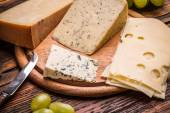 Assorted cheeses — Stock Photo