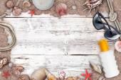 Suntan lotion and sea shells — Stock Photo