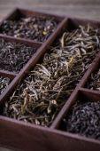Dry tea in wooden crate — Stock Photo