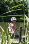 Boy fishing — Stock Photo